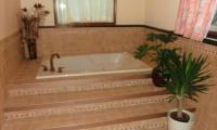 Whirlpool-tub-with-tiled-step-and-stage-.jpg